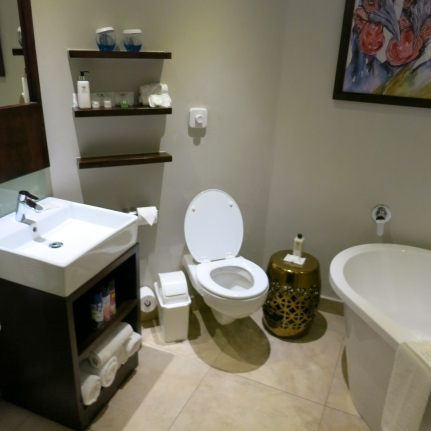 Raised bathroom with large luxury bath andseparate shower cubicle with massaging jets,bathrobes and guest amenities