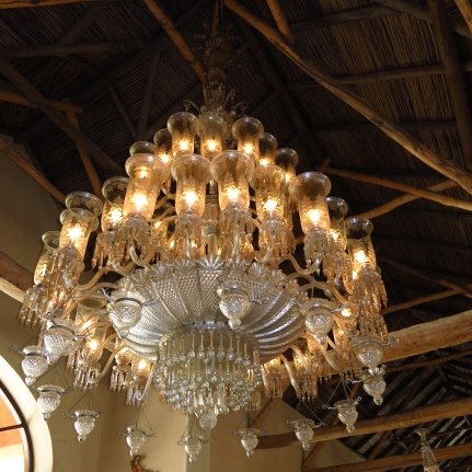 Glittering Indian chandeliers hang from the vaulted ceiling.