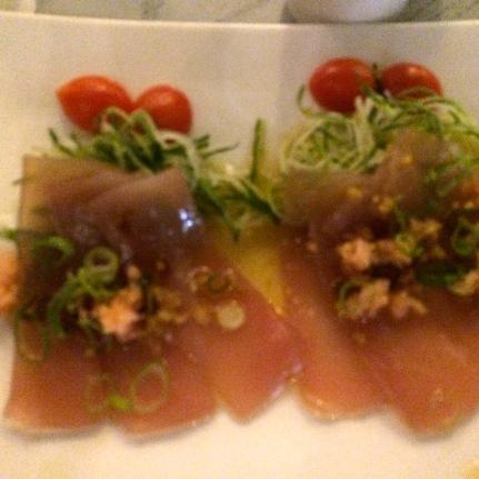 Tuna Tataki - slices of Tuna sashimi with spring onions, garlic, chili and ginger drizzled with Ponzu Sauce.