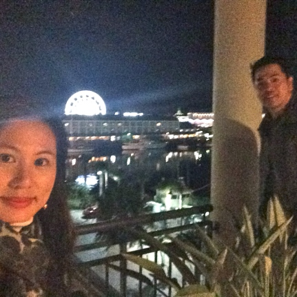 Enjoying the city lights from our balcony before calling it a night!