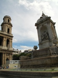 The front facade of the Saint-Sulpice church overlooks a pleasant square, laid out in the 18th century and named Place St. Sulpice after the church. The central fountain - the Fontaine des Quatre Points Cardinaux - was designed in 1844 by Joachim Visconti and shows four seated bishops who never became cardinal. Hence the name of the fountain, which can be translated as the Fountain of the Four Not Cardinals. The church has one of the world's largest organs, built between 1776 and 1781 after a design by Jean Chalgrin, who is best known as the architect of the Arc de Triomphe. The gilded pulpit of the Saint-Sulpice was designed in 1788 by Charles de Wailly. Another highlight can be found in the Chapelle des Anges (Angel Chapel), where Eugène Delacroix created impressive wall paintings, entitled 'Jacob Wrestling with the Angel' and 'Expulsion of Heliodorus from the Temple'.