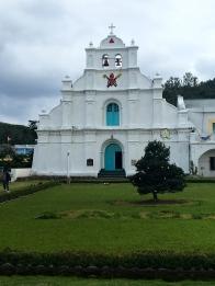 San Carlos Borromeo Church. Built in 1873 by Fr. Cresencio Polo using limestone walling in baroque style and cogon roofing.