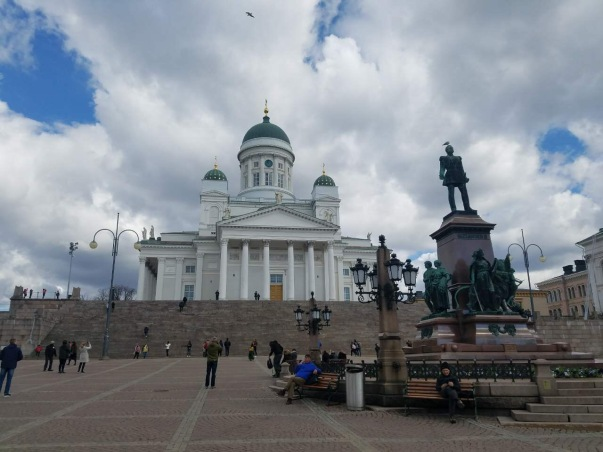 The Senate Square and its surroundings form a unique and cohesive example of Neoclassical architecture. The square is dominated by four buildings designed by Carl Ludvig Engel between 1822 and 1852: Helsinki Cathedral, the Government Palace, the main building of the University of Helsinki and the National Library of Finland. A statue of Alexander II (1894) stands in the middle of the Senate Square. Helsinki Cathedral is arguably Finland's most famous and photographed building; it celebrates its 165th anniversary in 2017. The oldest stone building in Helsinki is the Sederholm House located on the southeast corner of the square. Today the building hosts the Helsinki City Museum. The church is part of Helsinki's Empire era centre and a landmark for those arriving by sea. It has become the symbol of the whole of Helsinki. Earlier called St. Nicholas Church and Great Cathedral, the current main church of the Helsinki Diocese was completed in 1852. Sculptures of the twelve apostles guard the city from the roof of the church.