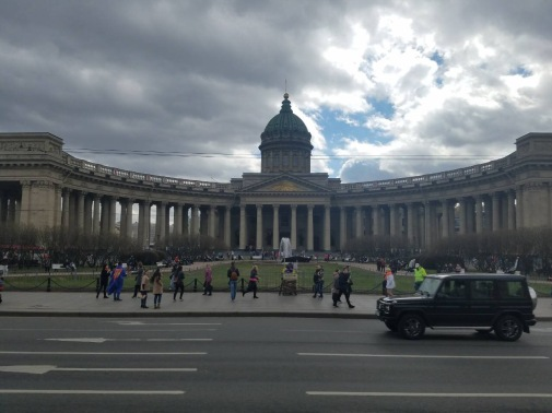 A sight of the Kazan Cathedral along Nevsky Prospekt. This neoclassical cathedral, partly modelled on St Peter's in Rome, was commissioned by Tsar Paul shortly before he was murdered in a coup. Its 111m-long colonnaded arms reach out towards the avenue, encircling a garden studded with statues. Inside, the cathedral is dark and traditionally orthodox, with a daunting 80m-high dome. There is usually a queue of believers waiting to kiss the icon of Our Lady of Kazan, a copy of one of Russia's most important icons.