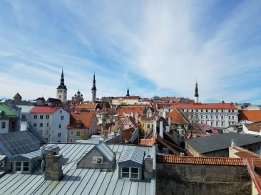 We were curious to see the views from the top of the city walls. We climbed a tall spiral staircase and stepped into this narrow plank balcony.