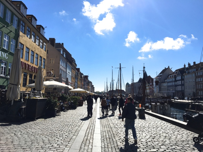 """Nyhavn is also called """"The longest outdoor bar in Scandinavia"""" - with its many restaurants - cafés and cozy eating places overlooking the canal."""