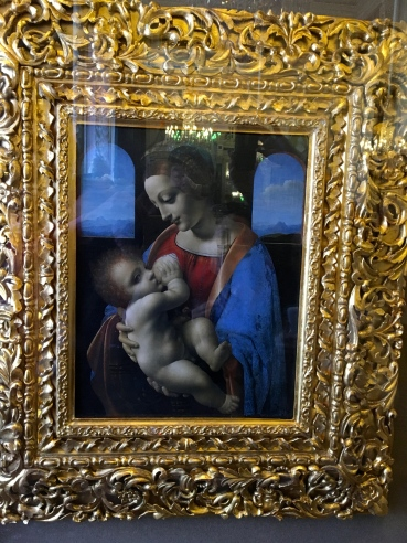 and the second one is the Madonna and Child (or Litta Madonna) from the 1490s. Da Vinci's style evolved in time. In contrast to the earlier Madonna, Leonardo da Vinci presents here an idealized version in which she epitomizes ultimate maternal love and devotion for a child. This is the humanist dream of Ideal Life, with pure love and idyllically peaceful surroundings.