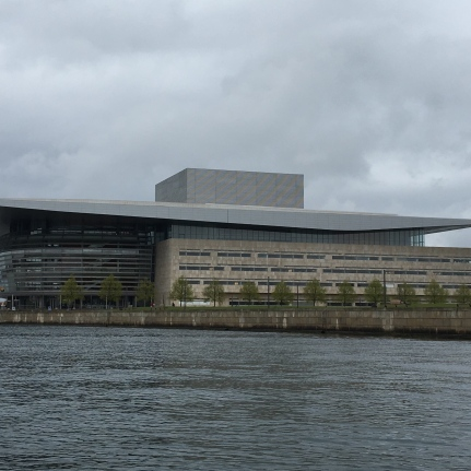 Seen from the outside, Copenhagen's Opera House, with its bubble-faced front gently squeezed by a flat, thin roof, is akin to a giant lantern on the city's waterfront. The front lodges a five-story foyer and another bubble, inspired by a conch, covered with golden Danish maple. The main auditorium is coated on the inside with dark maple and has three horseshoe-shaped balconies. It can seat up to 1,700 people. Besides the main stage, the opera has five side and back stages. Hydraulic machinery can change their size and enlarge the orchestra pit to hold up to 120 musicians. Maersk Mc-Kinney Moeller, one of Denmark's wealthiest men, changed his initial sketches for a $231-million concert hall into a monument to Danish design that ended up costing nearly twice as much.